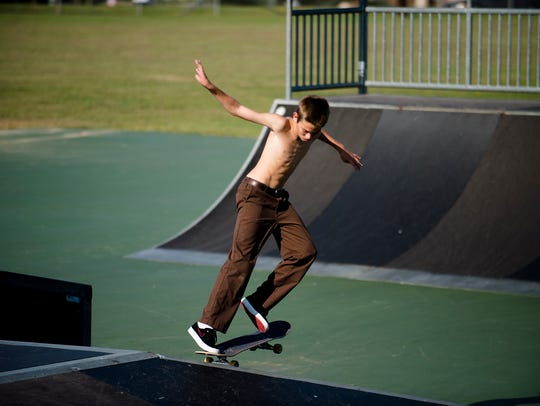 Oliver Reed, 14, skate boards at the Montgomery Skate