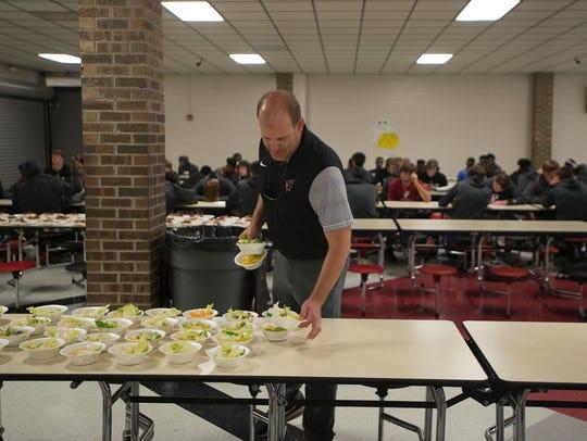 Prattville head coach Chad Anderson prepares a meal