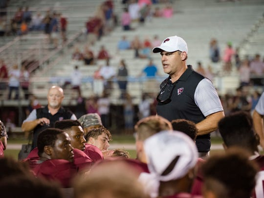 Prattville head coach Chad Anderson speaks to his players after their game against Lee High School on Friday, Sept. 22, 2017, in Prattville, Ala.