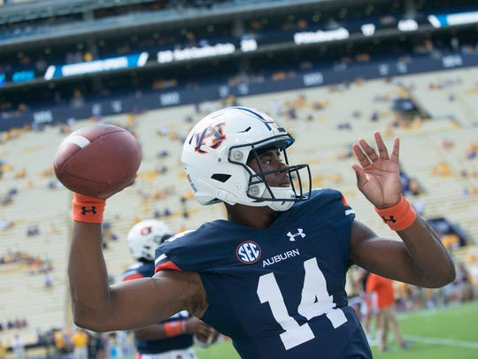 Auburn quarterback Malik Willis (14) throws a passbefore