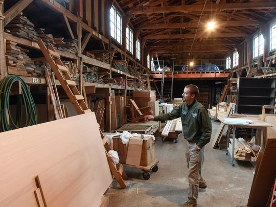 Land manager John Geissler looks at boards stored Friday,