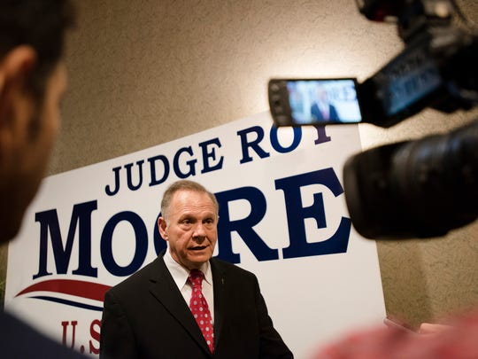 Republican Senate nominee Roy Moore speaks to members