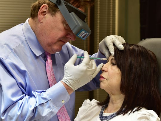 Dr. Kevin Welch administers a Botox treatment, which