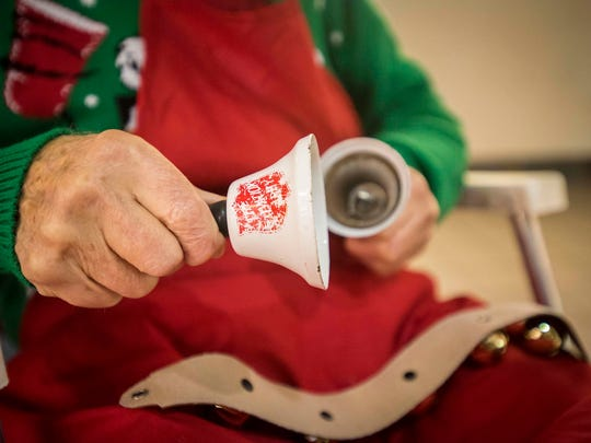William Miskell, 90, a volunteer for the Salvation Army, rings an assortment of hand bells and reindeer bells outside of Carson's in the Birchwood Mall Nov. 22. Miskell has been volunteering for the Salvation Army for seven years.