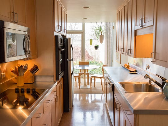 The long galley kitchen has been redone with maple