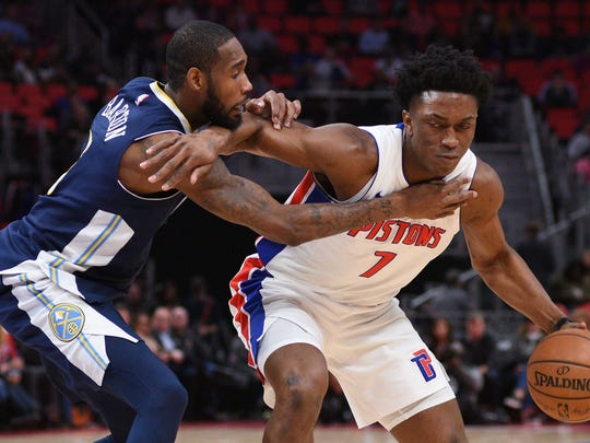 Pistons forward Stanley Johnson (7) drives to the basket against Nuggets guard Will Barton (5) during the fourth quarter of the Pistons' 103-84 loss on Tuesday, Dec. 12, 2017, at Little Caesars Arena.