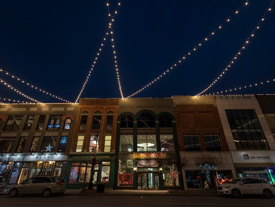 Lights hanging over Huron Avenue in downtown Port Huron