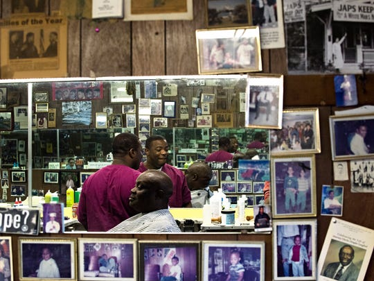 Spurgen Malden works to cut the hair of Roger Orum at Malden Brothers Barber Shop in Montgomery, Ala., on Tuesday, Aug. 22, 2017.