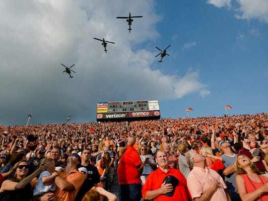 Helicopters fly in before the NCAA football game between Auburn and Mississippi State on Saturday, Sept. 30, 2017 in Auburn, Ala.