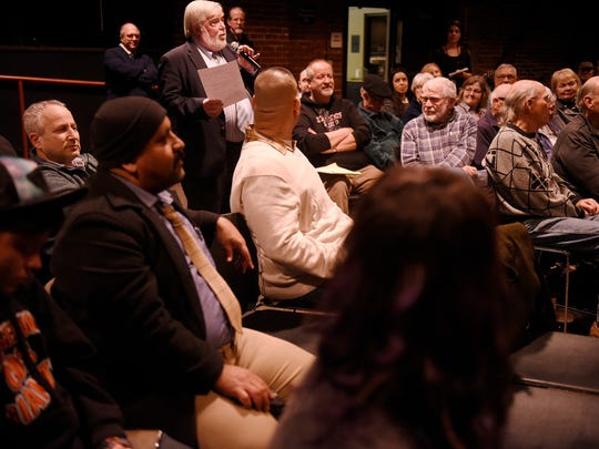 Moderator Paul Hurley asks a question during 210 Connect Monday, now in its 10th year at 210, a community center which is owned and operated by the First Presbyterian Church in Visalia.