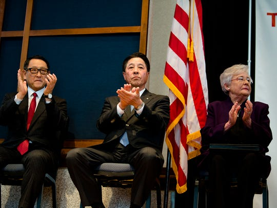 From right, Governor Kay Ivey, Masamichi Kogai, Mazda Moror Corporation president and CEO, Akio Toyoda, Toyota Motor Corporation president, clap during a press conference on Wednesday, Jan. 10, 2018, in Montgomery, Ala. The press conference was held to announcing production plants to be build by Mazda and Toyota in Huntsville, Ala.