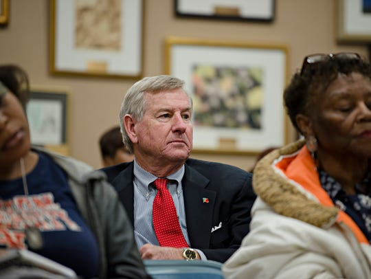 Mayor Todd Strange looks on during a meeting held by