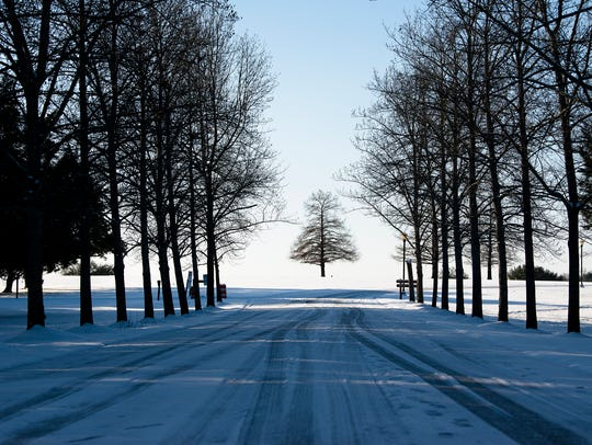 Ice covers the road into Blount Cultural Park in Montgomery,
