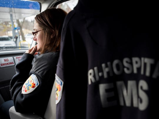 Tri-Hospital EMS Paramedic Operations Manager Trish May waits in an ambulance two years ago. First responders on the front lines of the coronavirus outbreak are implementing additional screening measures to protect themselves and slow the spread of the virus. Brian Wells/Times Herald.