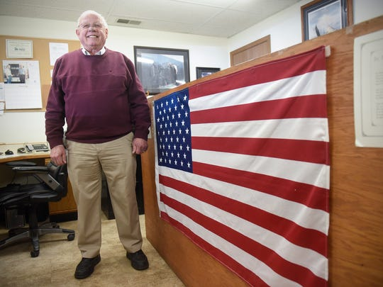 Ron Harper stands next to a large U.S. flag hanging near his office at Quality Appliance Friday, Jan. 19, in Waite Park.