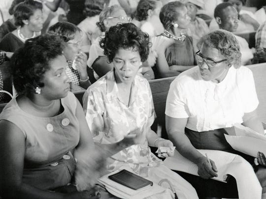 This photograph from the Herbert Randall Freedom Summer Photographs held in the McCain Library and Archives at the University Southern Mississippi, shows civil rights leaders from left, Marie Blalock, Peggy Jean Connor and Vassie Patton in a crowded Mississippi Freedom Democratic Party meeting on the front pew in the sanctuary of probably St. Paul United Methodist Church. Connor was treasurer of the Hattiesburg Freedom Summer project and state executive secretary of the MFDP.