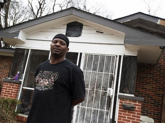 Harvey Knight stands in front of his house on Michaels Street in Montgomery, Alabama on Monday, Feb. 12, 2018.