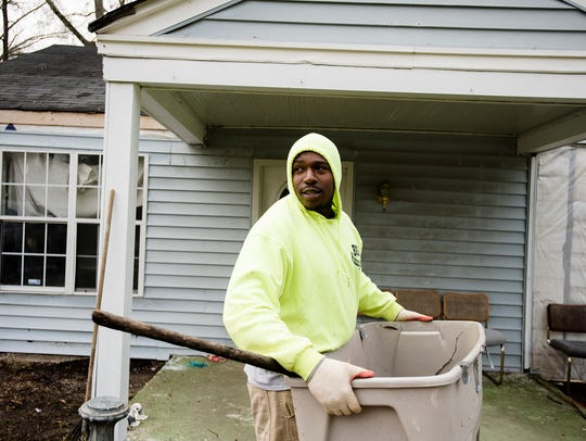 John Burt works on his fathers house in Montgomery,