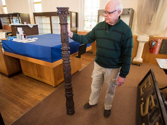Chuck Homberg, member of the St. Clair Historical commission, holds a piece of oak trim that was donated to the St. Clair Historical Museum Feb. 27. The piece is part of a collection of ornate oak paneling that was recently donated to the museum by the Port Huron Museum.