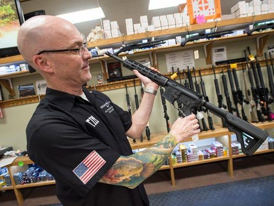 636554122830827165-20180228-assault-rifle-sales-0002.jpg