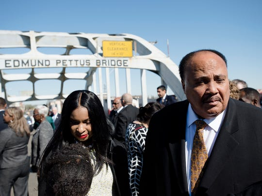 Martin Luther King III stands on the Edmund Pettus Bridge on Sunday, March 4, 2018, in Selma, Ala., during the Faith and Politics Institute Congressional Civil Rights Pilgrimage.