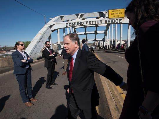 Senator Doug Jones walks with his wife, Louise, on