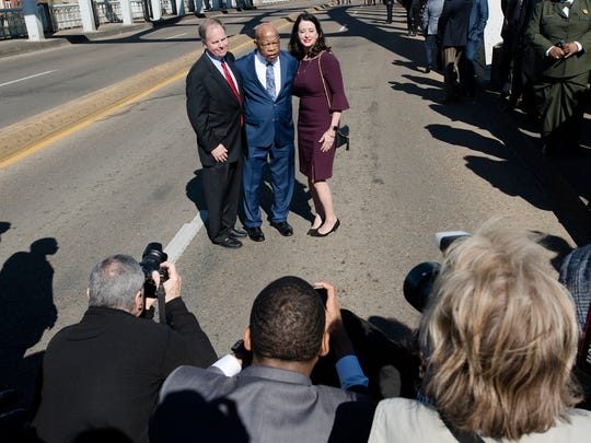 Senator Doug Jones, left, and his wife, Louise, pose with Congressman John Lewis for a photograph on the Edmund Pettus Bridge on Sunday, March 4, 2018, in Selma, Ala., during the Faith and Politics Institute Congressional Civil Rights Pilgrimage.