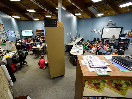 Teachers try to create makeshift boundaries for their classrooms with file cabinets stacked high, large bulletin boards, and rolling cabinets at Pleasantview Elementary School  Tuesday, March 6, in Sauk Rapids