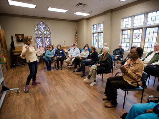 Daphne Johnston, Respite Ministry director, leads a class with elderly suffering from dementia during the Respite Ministry activities at First United Methodist Church in Montgomery, Ala., in Monday, March 12, 2018.