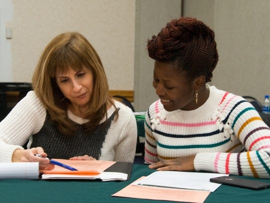 Sanofi mentor Filomena Masullo (left) works with RVCC