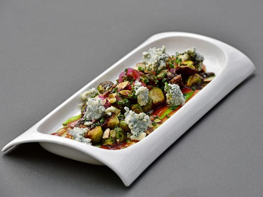 Roasted Brussels Sprouts with Toasted Almonds, Asher Blue Cheese and Tabasco Wildflower Honey.