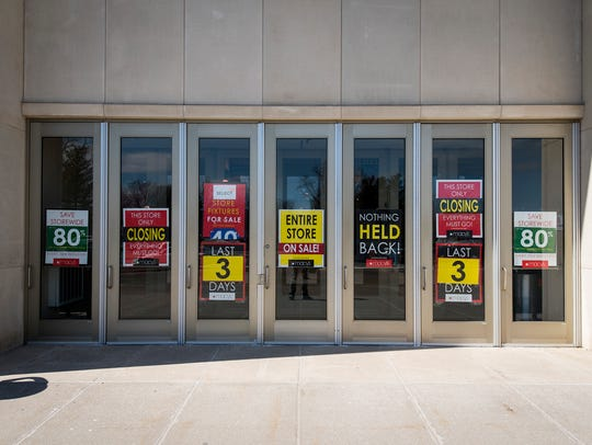 Signs advertising the final days of Macy's in the Birchwood