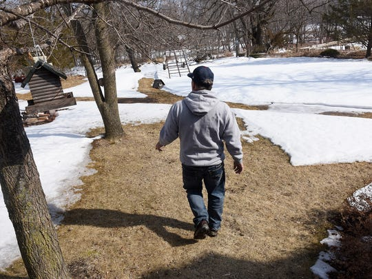 Bill Davison walks to the Mississippi River shoreline at his home on the river Thursday, March 22, north of Sartell.