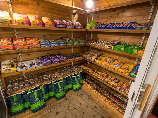 The former humidor inside Sandler's Party Store in Fort Gratiot has been converted into a pantry for pet food items as part of the Ben and Zoe Project, a program offering free food and supplies for dogs and cats.