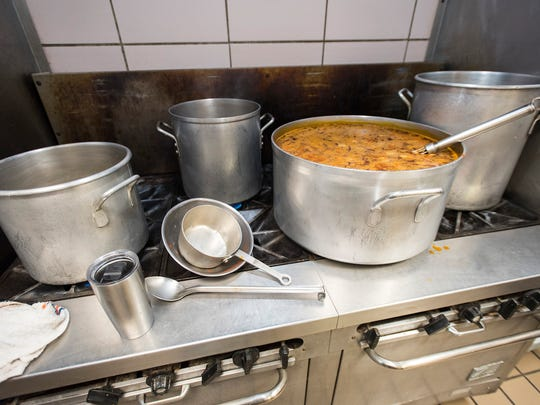 A 10-gallon pot of chili sits on the stove in the kitchen