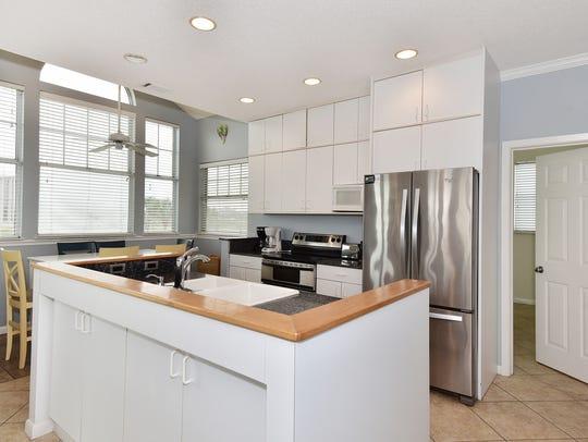 1001 Maldonado Drive, the kitchen with an island.