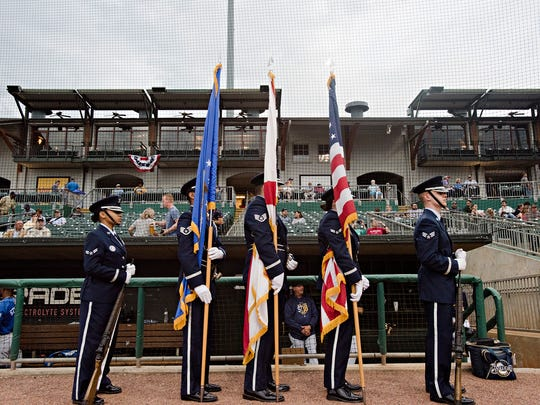 Air Force color guard from Maxwell airfare base prepares to present the colors before the Biscuits game on Friday, April 6, 2018, in Montgomery, Ala.