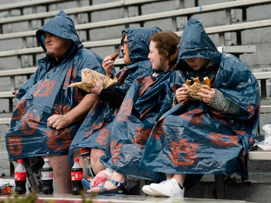 Fans eat food in Jordan Hare Stadium before the Auburn A-Day game on Saturday, April 7, 2018, in Auburn, Ala.