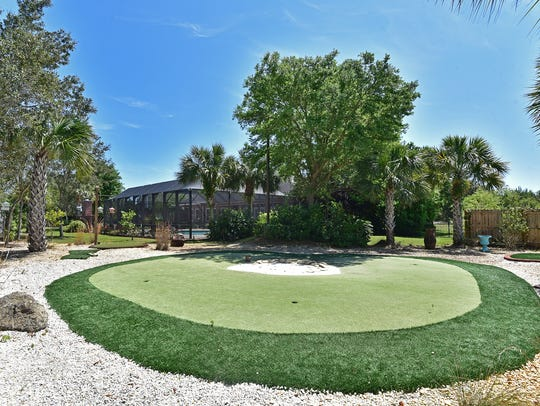 1444 West Shores Boulevard, the on-site putting green.