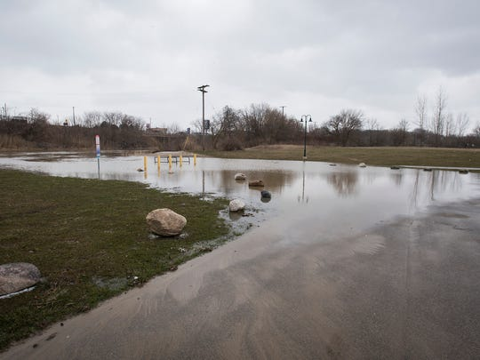 The Black River floods into Bakersfield Park in Port Huron Tuesday, April 17.