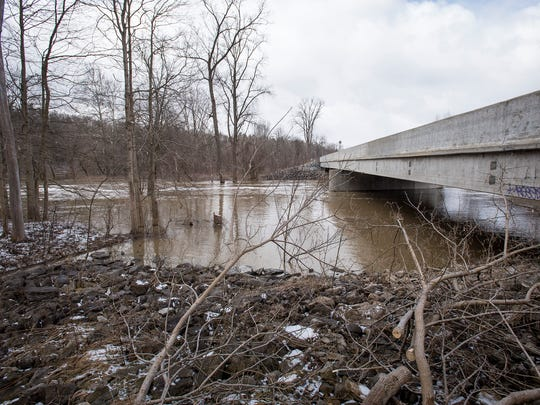The Black River flows under the Beard Road bridge in North Street Tuesday, April 17.