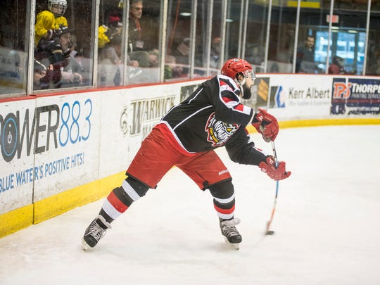 Port Huron Prowlers player Joe Pace Jr. passes the