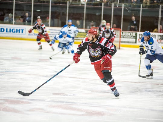 Port Huron Prowlers player Yianni Liarakos skates down the ice with the puck during the first game of the Commissioner's Cup playoffs against the Watertown Wolves at McMorran Arena Friday, April 20.