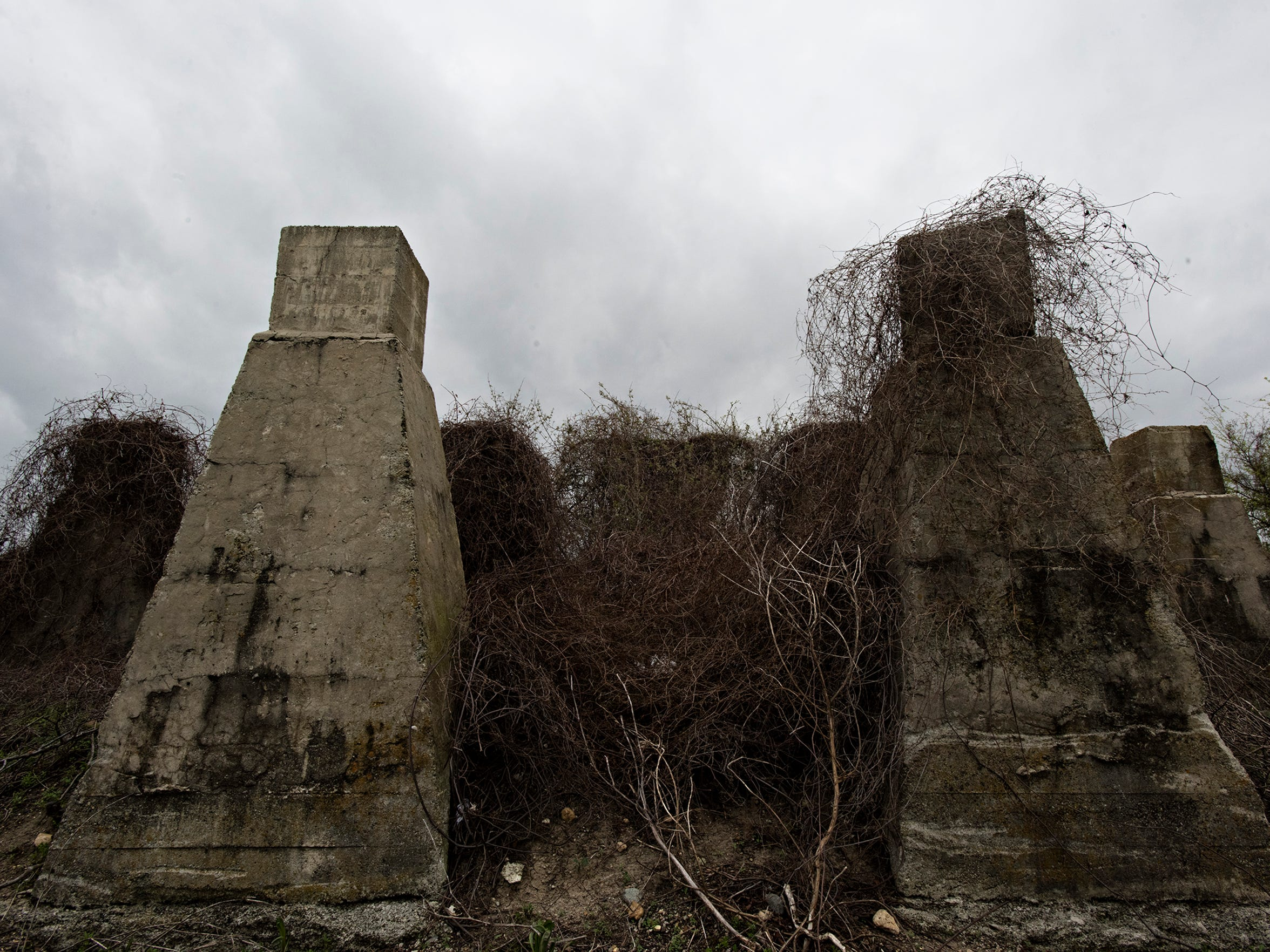 The supports of a railroad water tower that is believed to be the site of the lynching of men who were attempting to flee Elaine, Arkansas, by rail during the 1919 Elaine Massacre. James White, Elaine Legacy Center director, said the men were hanged and left for days from the water tower on the railroad used to refill trains.