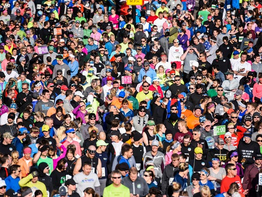 In 2018, runners got ready for the start of the Earth Day Half Marathon in St. Cloud.