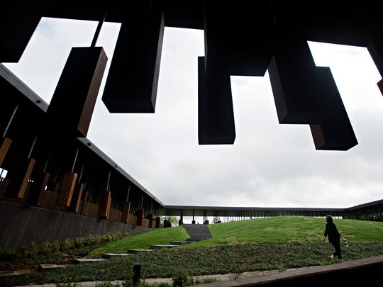 A pedestrian walks through the EJI's National Memorial