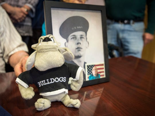 A stuffed bulldog sits next to a framed photo of Russel Collins, who will be 93, from his time in the U.S. Navy. On Thursday, April 26, Collins was presented with the Spirit of the Bulldog Award by representatives from Yale High School. He would have graduated in 1943, but he was drafted to fight in World War II.