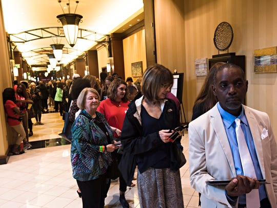 Gordon Hatchett of New York and Louisiana, waits in the registration line at EJI's Symposium at Renaissance Hotel on Thursday, April 26, 2018, in Montgomery, Ala.