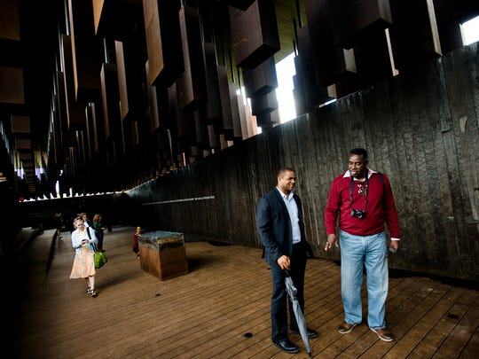 Visitors walk through EJI's National Memorial for Peace and Justice in Montgomery, Ala., on Thursday, April 26, 2018.