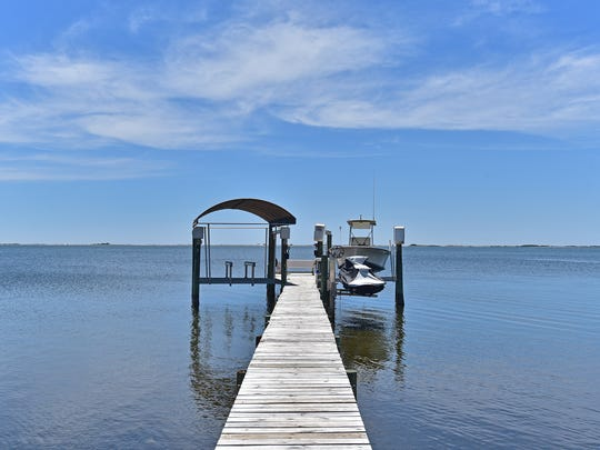 4441 Soundside Drive, the private dock and boat lift.